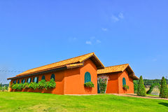 Orange house. In the garden Royalty Free Stock Image