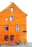 Orange house with bike Royalty Free Stock Image