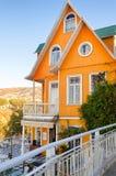 Orange house on black and white tiles Royalty Free Stock Photos
