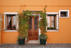 Orange house Burano. Vibrant house on the island of Burano in the Venetian lagoon - Italy. Just 30 minutes by boat from the centre of the town Stock Photography