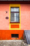 Orange house facade with wooden window from Sighisoara city old Royalty Free Stock Images
