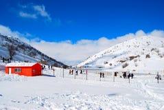 Orange house in the snow