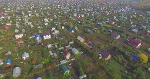Orange house in a village. Aerial stock video