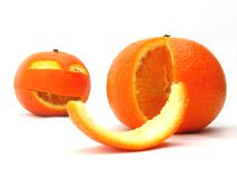 Orange humour. Two oranges on white background, one looking like halloween pumpkin with a big smile Stock Photo