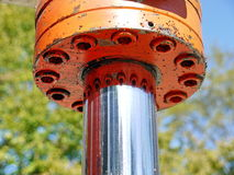 Orange hydraulic cylinder Royalty Free Stock Photos
