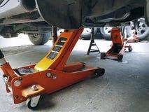 Orange Hydraulic Jacks for Car Repair Service. Orange Hydraulic Jacks for Car Lifting During Repair Service stock images