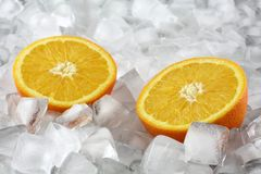 Orange on ice Stock Photography