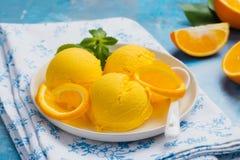 Orange ice cream. Summer orange sorbet. Homemade orange ice cream with thyme and orange slices Royalty Free Stock Photography