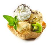 Orange ice cream in waffle basket royalty free stock photos
