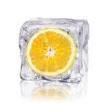 Orange in an ice cube. A orange enclosed in an ice cube before white background royalty free stock photos
