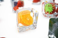 Orange in ice cube isolated on white with depth of field effects. Ice cubes with fresh berries. Berries fruits frozen in. Ice cubes. 3D rendering Stock Images