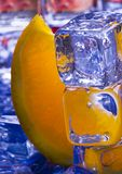 Orange with ice cubes Royalty Free Stock Photography
