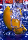 Orange with ice cubes Stock Photography