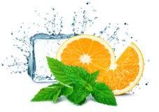 Orange, ice cubes splash. Isolated on white Royalty Free Stock Photography