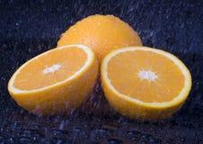 Orange im Regen Lizenzfreie Stockbilder