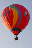 Orange IMTS Balloon sailing in sky Stock Photography