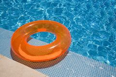 Orange inflated rubber pool. Orange inflated rubber inflateble in the pool Royalty Free Stock Image