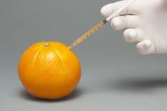 Orange injectée Photographie stock libre de droits