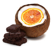 Orange inside coconut and pieces of chocolate isolated on white Royalty Free Stock Image