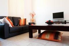 Orange Interior. Trendy Orange and Brown Lounge Room Royalty Free Stock Image