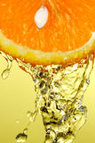 Orange isolated. Macro of an orange with water isolated on yellow background royalty free stock image