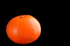 Orange isolated on black Stock Photos