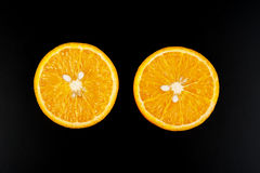 Orange isolated on black background. Two part of orange isolated on black background Royalty Free Stock Photos