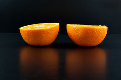 Orange isolated on black background. Two part of orange isolated on black background Royalty Free Stock Photography