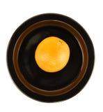 Orange Isolated on Black Serving Dish Stock Image