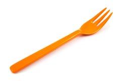 Orange isolerade plast-gafflar Arkivbilder