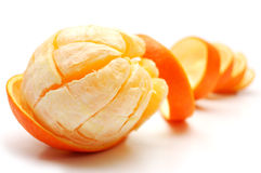 Orange and its rind in spiral form stock images