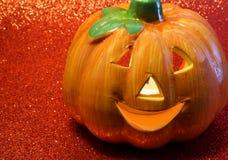 Orange jack o lantern symbols of Halloween. With candle inside Royalty Free Stock Photography