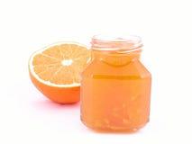 Orange jam. Jar of orange jam isolated on white Royalty Free Stock Images