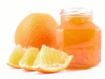 Orange jam. Jar of orange jam isolated on white Stock Images