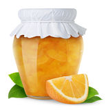 Orange jam. Isolated fruit jam. Glass jar with orange jam closed with paper lid isolated on white background Royalty Free Stock Photo