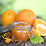 Orange jam. In a preserving glass Royalty Free Stock Images