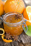 Orange jam. In a preserving glass Stock Images