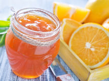 Orange jam. In the bank Royalty Free Stock Images