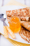 Orange jam with crepes Stock Image