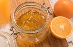 Orange jam in a glass bowl Stock Photos