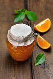 Orange jam in glass jar Stock Images