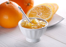 Orange jam in the jar Stock Photos