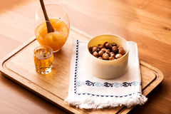 Orange jam, liquor,nuts and traditional design napkin Royalty Free Stock Photo