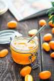 Orange Jam in Retro Jar with Recipe Book on the Background. Vertical View Stock Photos