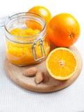 Orange jam and ripe oranges stock photos