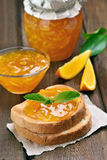 Orange jam on toast Stock Images