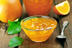 Orange jam on wooden table Royalty Free Stock Images