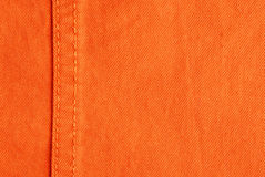 Orange jeans. Fabric and sewing detail Royalty Free Stock Photography