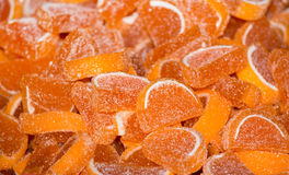 Orange jelly beans on pile. Fruity orange slices of jelly beans on pile. Close up of confectionery desserts royalty free stock photography