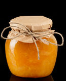 Orange Jelly In Glass Jar Isolated On Black Stock Image